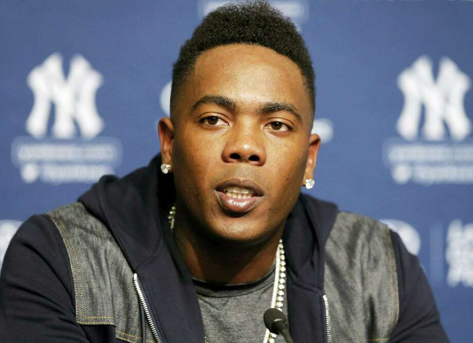 Aroldis Chapman answers a question during a press conference at Yankee Stadium on Sunday. Photo: Kathy Willens — The Associated Press  / Copyright 2016 The Associated Press. All rights reserved. This material may not be published, broadcast, rewritten or redistribu