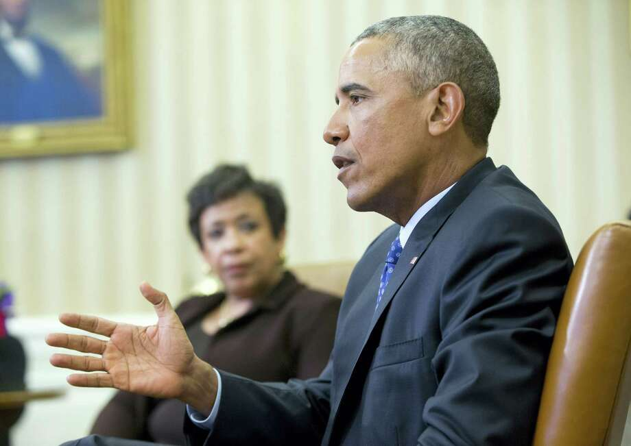 Attorney General Loretta Lynch listens as President Barack Obama speaks in the Oval Office of the White House in Washington, Monday, Jan. 4, 2016, during a meeting with law enforcement officials to discuss executive actions the president can take to curb gun violence. The president is slated to finalize a set of new executive actions tightening U.S. gun laws, kicking off his last year in office with a clear signal that he intends to prioritize one of the country's most intractable issues.  (AP Photo/Pablo Martinez Monsivais) Photo: AP / AP