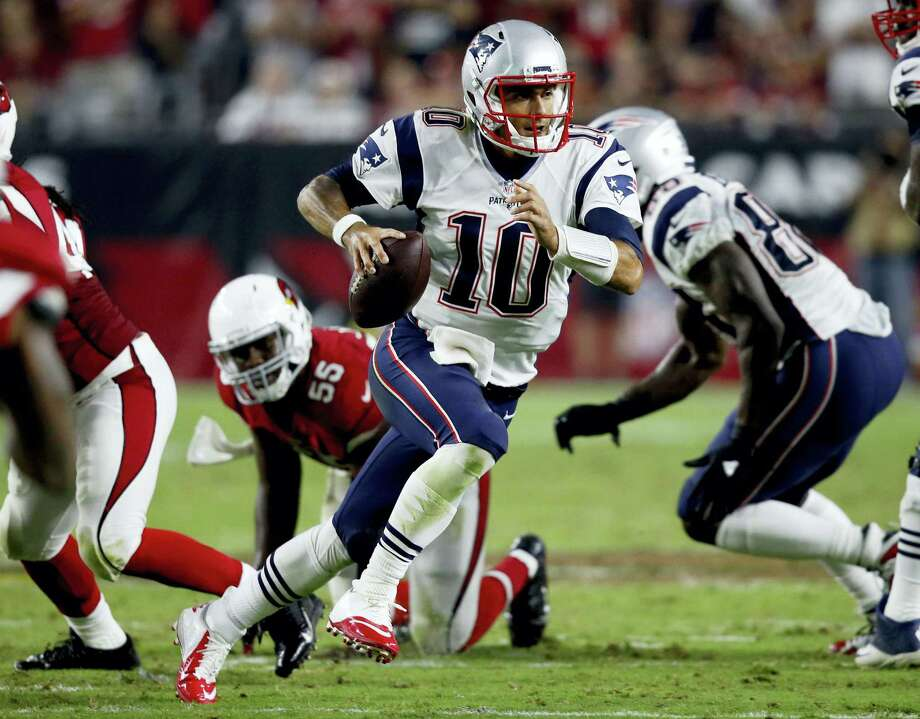 Patriots quarterback Jimmy Garoppolo scrambles against the Cardinals during the second half on Sunday. Photo: Ross D. Franklin — The Associated Press  / AP