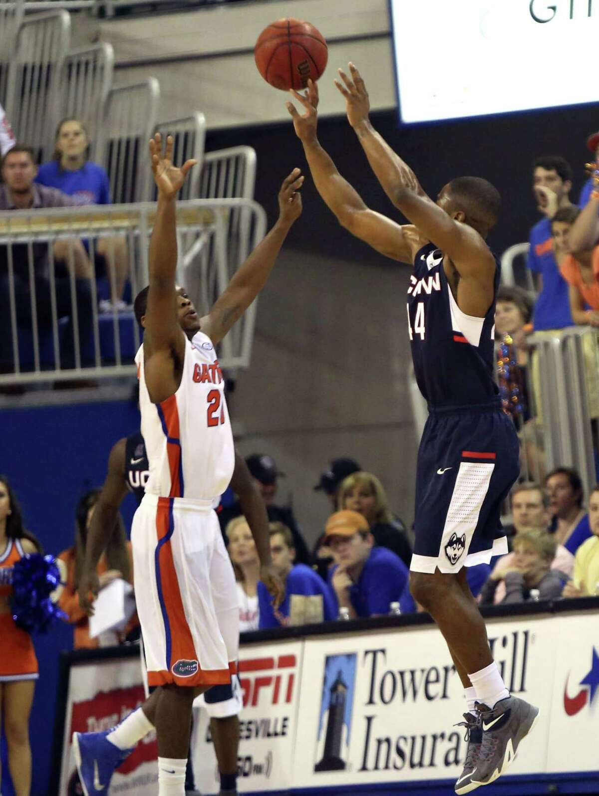 UConn's Rodney Purvis knocks down a 3-pointer over Florida's Michael Frazier II late in the second half of the Huskies' 63-59 win on Saturday in Gainesville, Fla.
