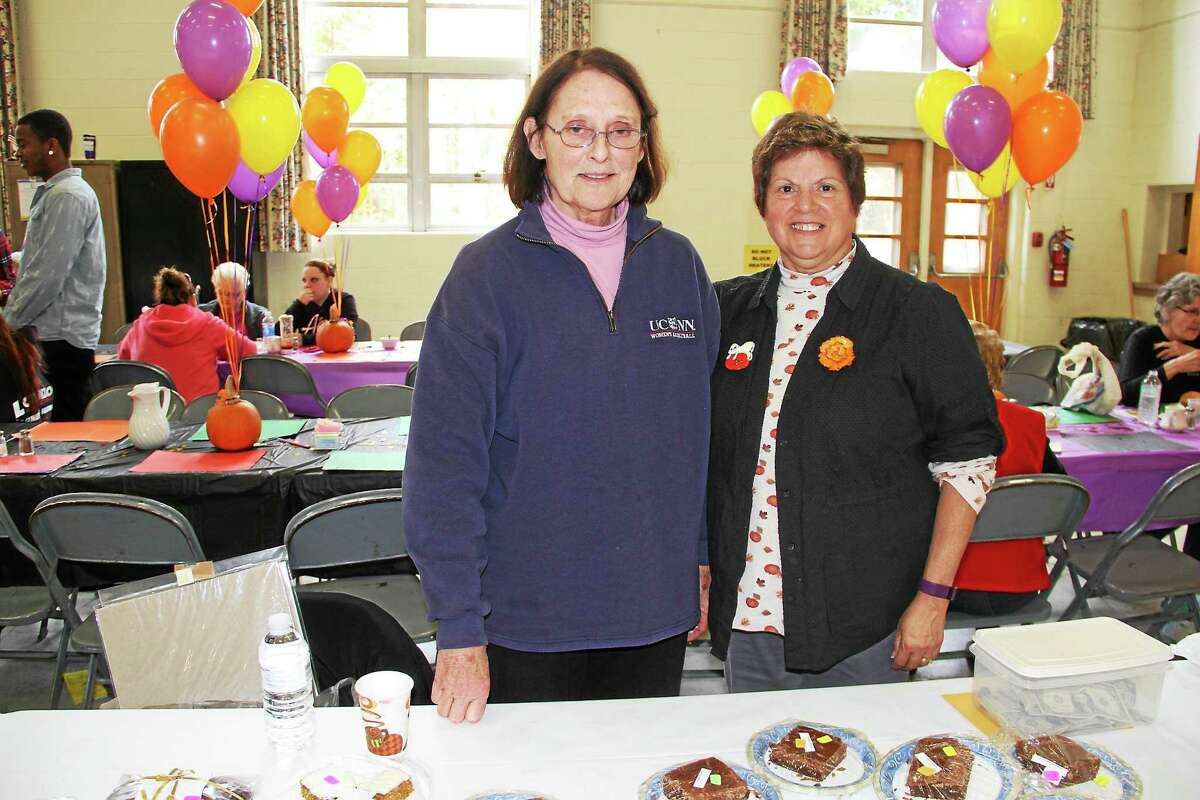 Connie Christian, left, and Camille Wesneski, both of Harwinton, at the baked goods and cheese booth at the First United Methodist Church Fall Fest and Craft Fair held Saturday.