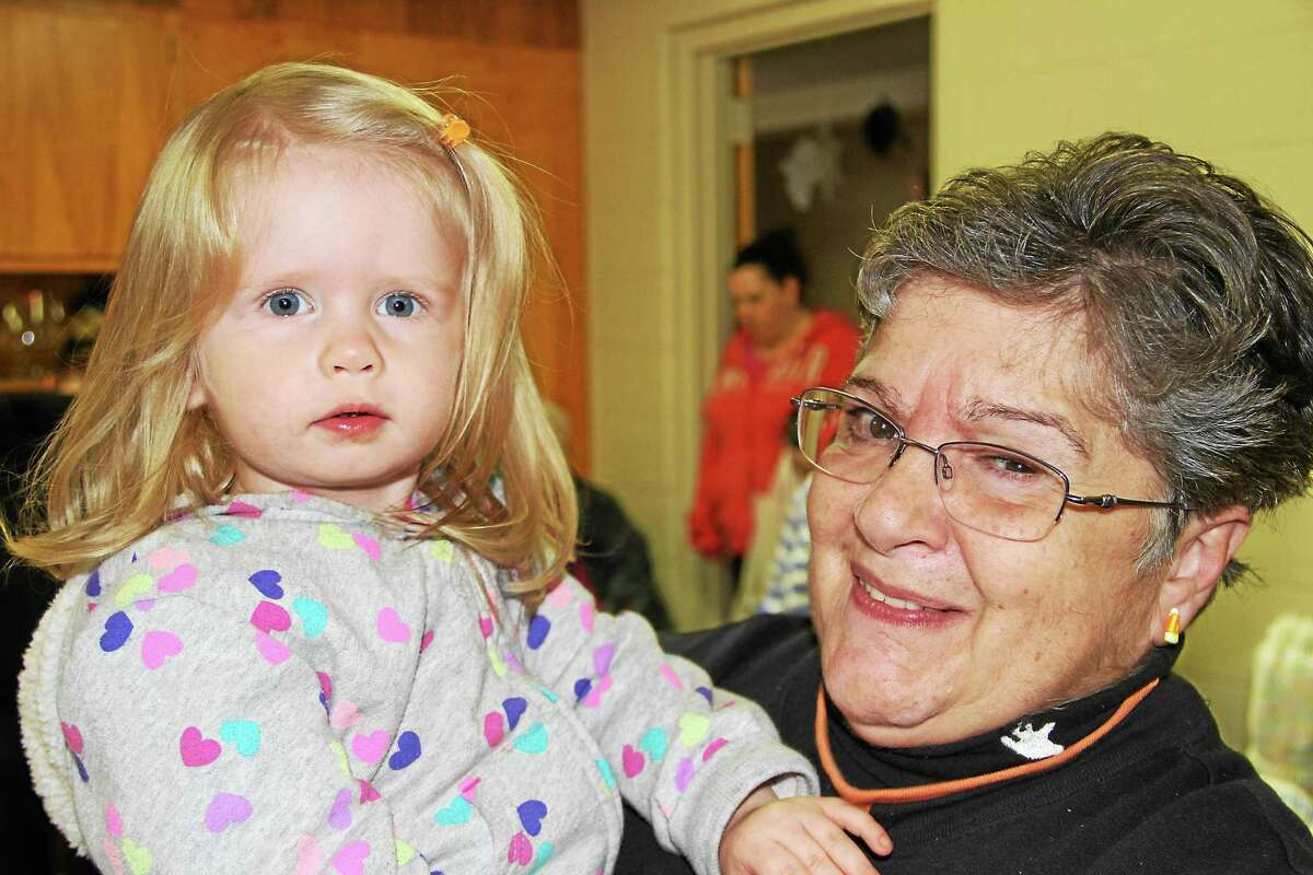 Debbie Thomas, a fair vendor, holds her granddaughter, Emily Thomas, 2.