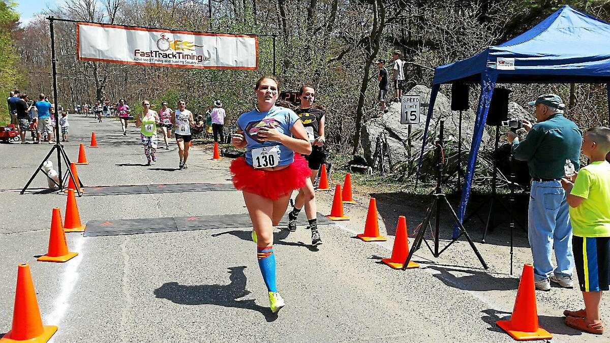 Sarah Auch of Greenwich, front, and Allie Gluck of Weston finish the race Sunday.
