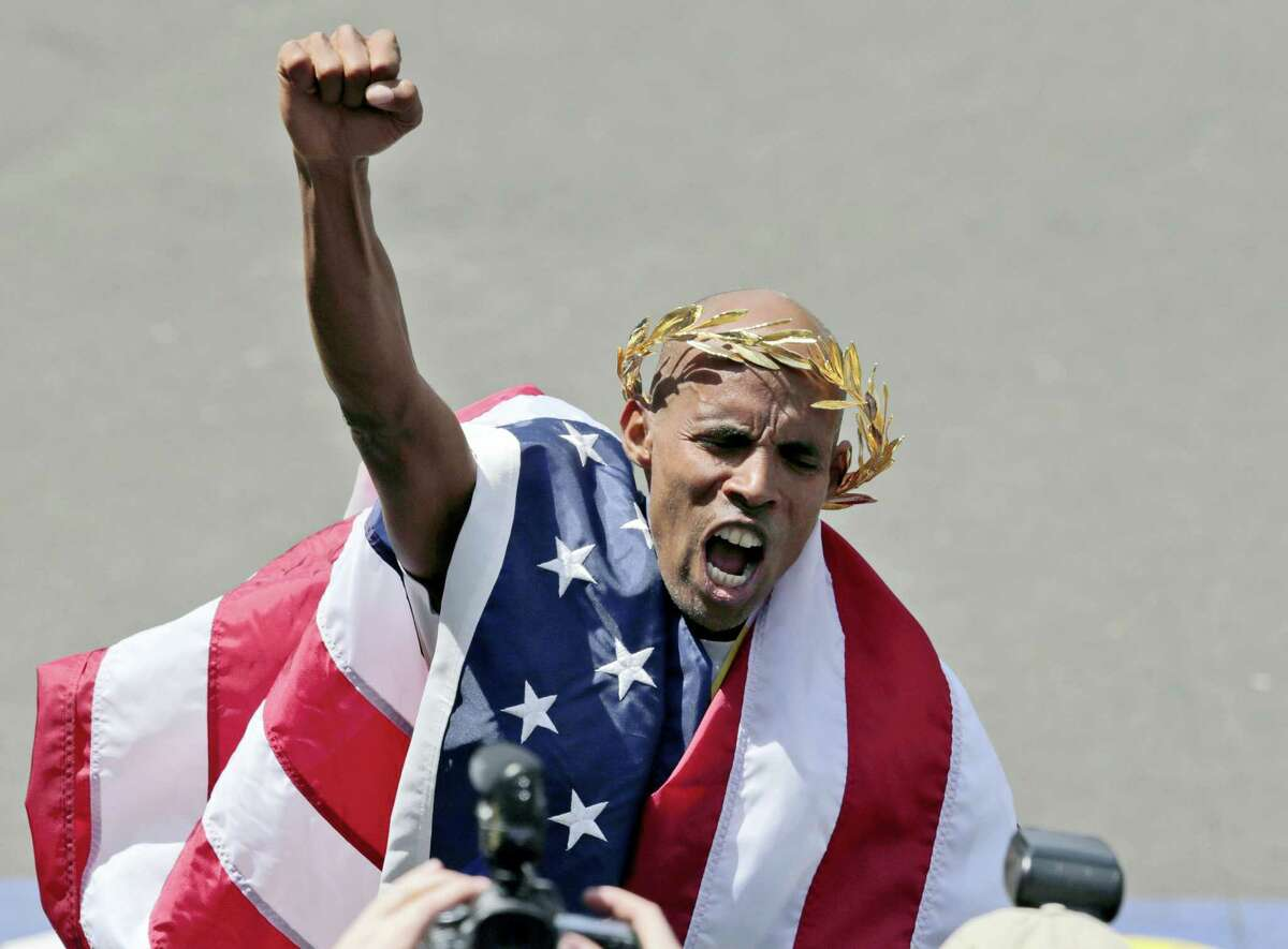 In this 2014 file photo, Meb Keflezighi celebrates his victory in the 118th Boston Marathon. Keflezighi was the first American man to win the race in 31 years. The first feature-length documentary film highlighting historical moments of the nation's oldest marathon is in the works, tentatively set to premiere in April 2017 in conjunction with the 121st running of the race.