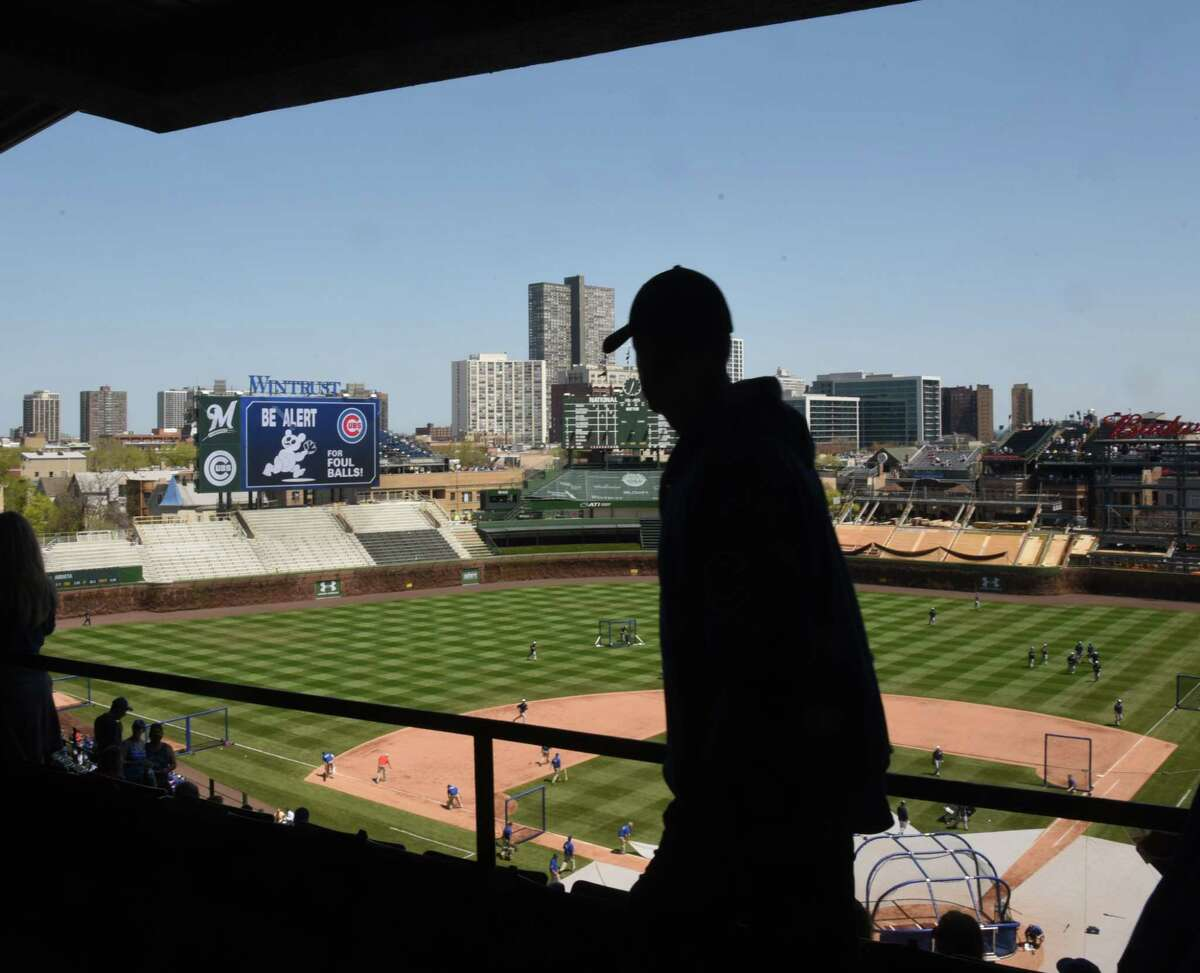 A fan walks along the concourse before a game between the Cubs and the Milwaukee Brewers on Saturday in Chicago.