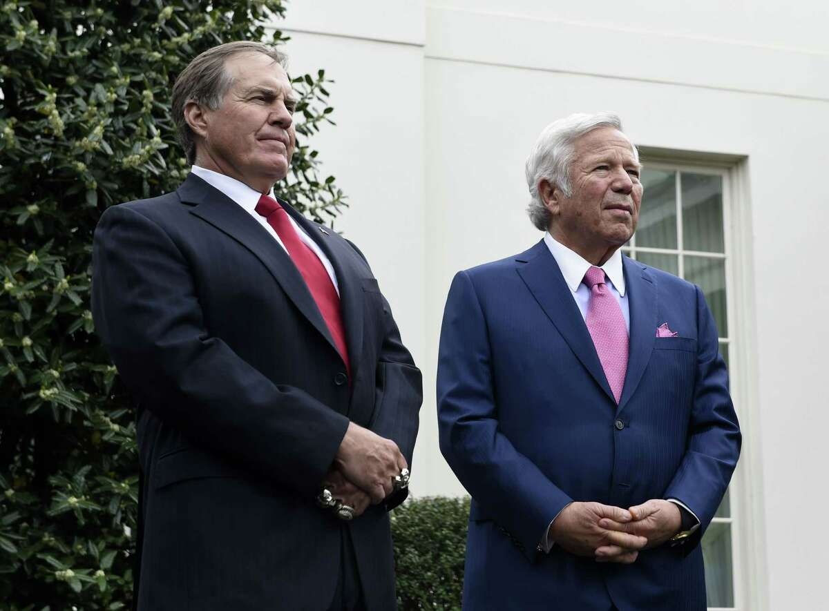 New England Patriots head coach Bill Belichick, left, and team owner Robert Kraft speak to the media outside the White House on Thursday in Washington.