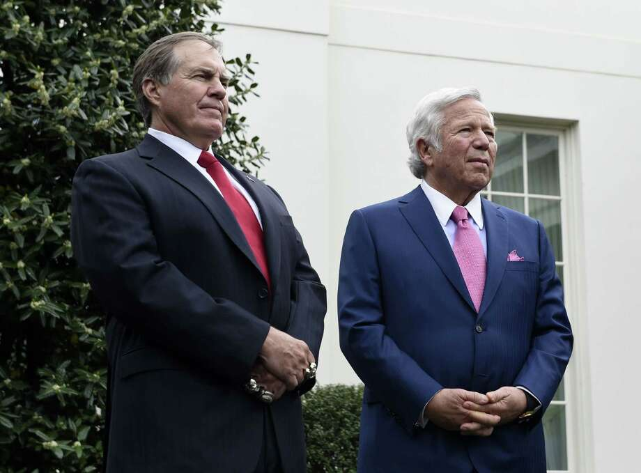 New England Patriots head coach Bill Belichick, left, and team owner Robert Kraft speak to the media outside the White House on Thursday in Washington. Photo: Susan Walsh — The Associated Press  / AP