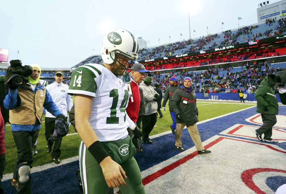 Jets quarterback Ryan Fitzpatrick leaves the field after Sunday's loss to the Bills. Photo: Bill Wippert — The Associated Press  / FR170745 AP