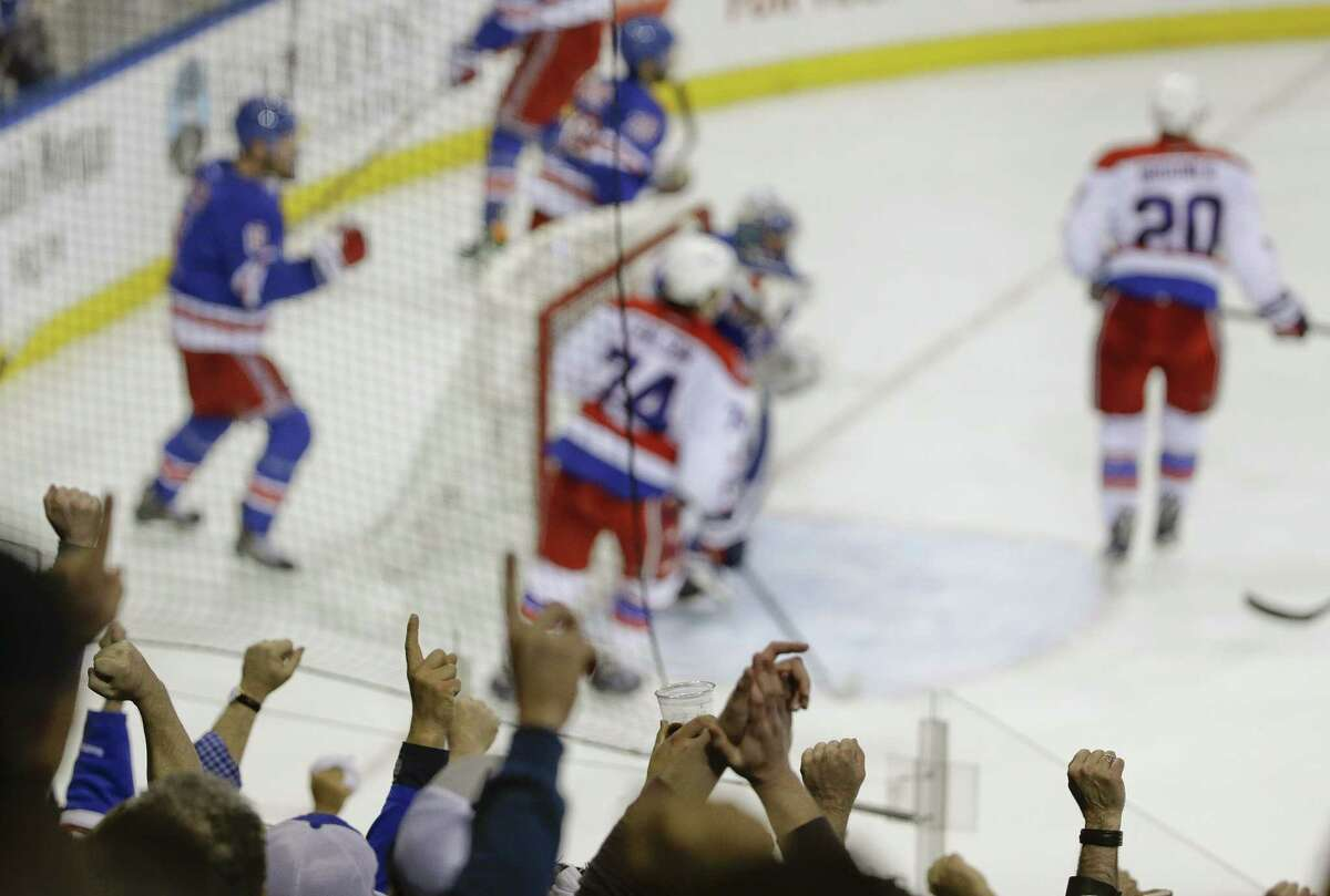 Rangers fans celebrate after a 3-2 win over the Washington Capitals in Game 2 of their second-round series on Saturday in New York.