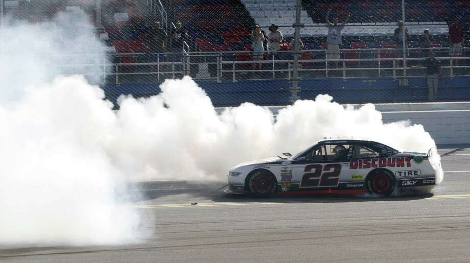 Winner Joey Logano celebrates with a burnout at the NASCAR Xfinity race at Talladega Superspeedway on Saturday in Talladega, Ala. Photo: Ron Sanders — The Associated Press  / FR159559 AP