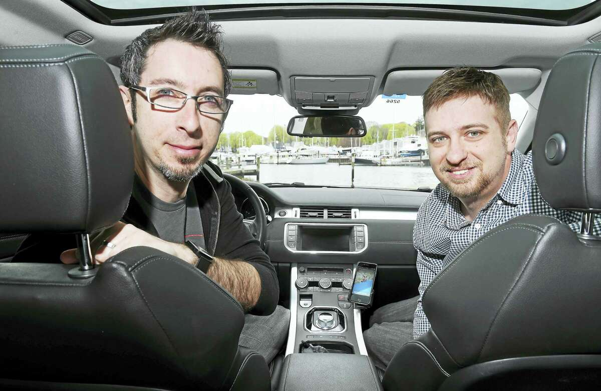 (Arnold Gold-New Haven Register) Stephen Barrante, left, and Rob Kurfehs, shown in Milford recently, created a scenic navigation app, Round, for the iPhone that enables users to both find and record scenic driving and walking routes.