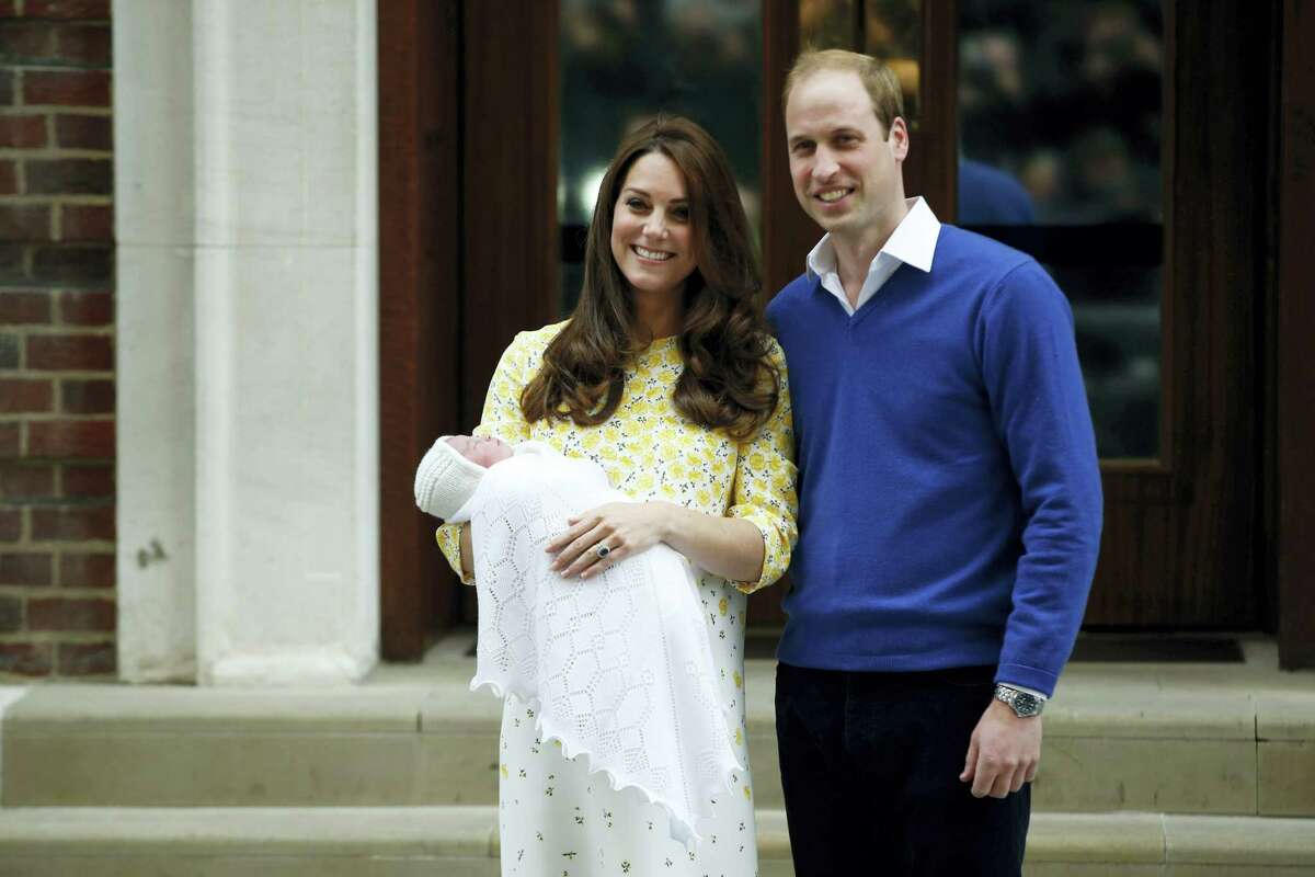 Britain's Prince William, right, and Kate, Duchess of Cambridge, hold their newborn daughter as they pose for the media outside the St. Mary's Hospital's exclusive Lindo Wing, London on May 2, 2015.
