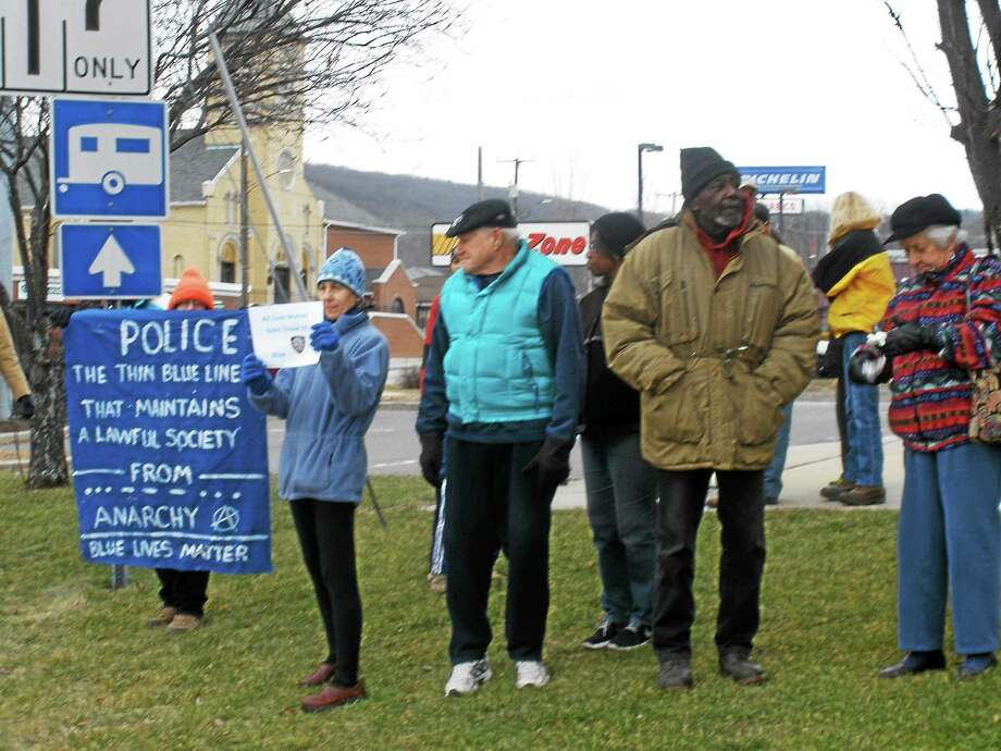 A crowd of supporters outside the Torrington Police Department show their appreciation for officers. Photo by Stephen Underwood Photo: Journal Register Co.