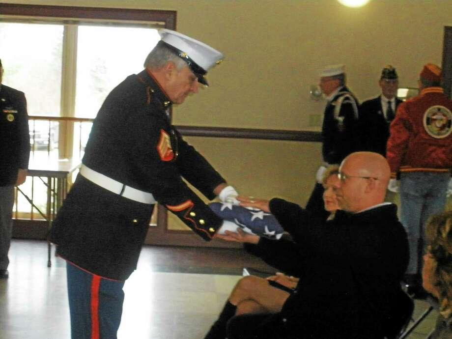 Family members and veterans honor deceased U.S. Navy Korean War veteran Calvin Warner Strong at the Veteran of the Month ceremony in Bantam. Photo by Stephen Underwood Photo: Journal Register Co.