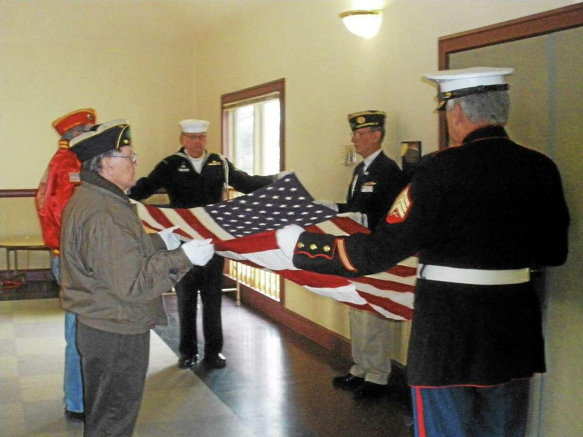 Family members and veterans honor deceased U.S. Navy Korean War veteran Calvin Warner Strong at the Veteran of the Month ceremony in Bantam. Photo by Stephen Underwood