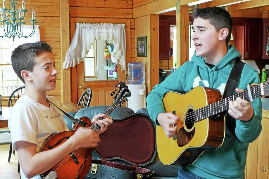 Sam and Ben Zolla practice in their Torrington home. Photo: John Fitts — The Register Citizen