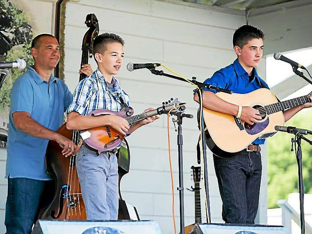 The Zolla Boys play at the Jenny Brook Bluegrass Festival in Vermont. From left are Larry, Sam and Ben.