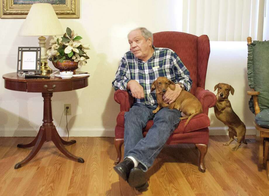 "Larry Wilkins retells the story of how his dogs, Bonnie and Pete (left), alerted him to a noise on his front porch, where he would meet the seven-year-old sole survivor of a airplane crash. ""I come to the door and there's a little girl, 7 years old, bloody nose, bloody arms, bloody legs, one sock, no shoes, crying,"" Wilkins, 71, told The Associated Press on Saturday. ""She told me that her mom and dad were dead, and she had been in a plane crash, and the plane was upside down."" (AP Photo/The Paducah Sun, John Paul Henry) Photo: AP / The Paducah Sun"