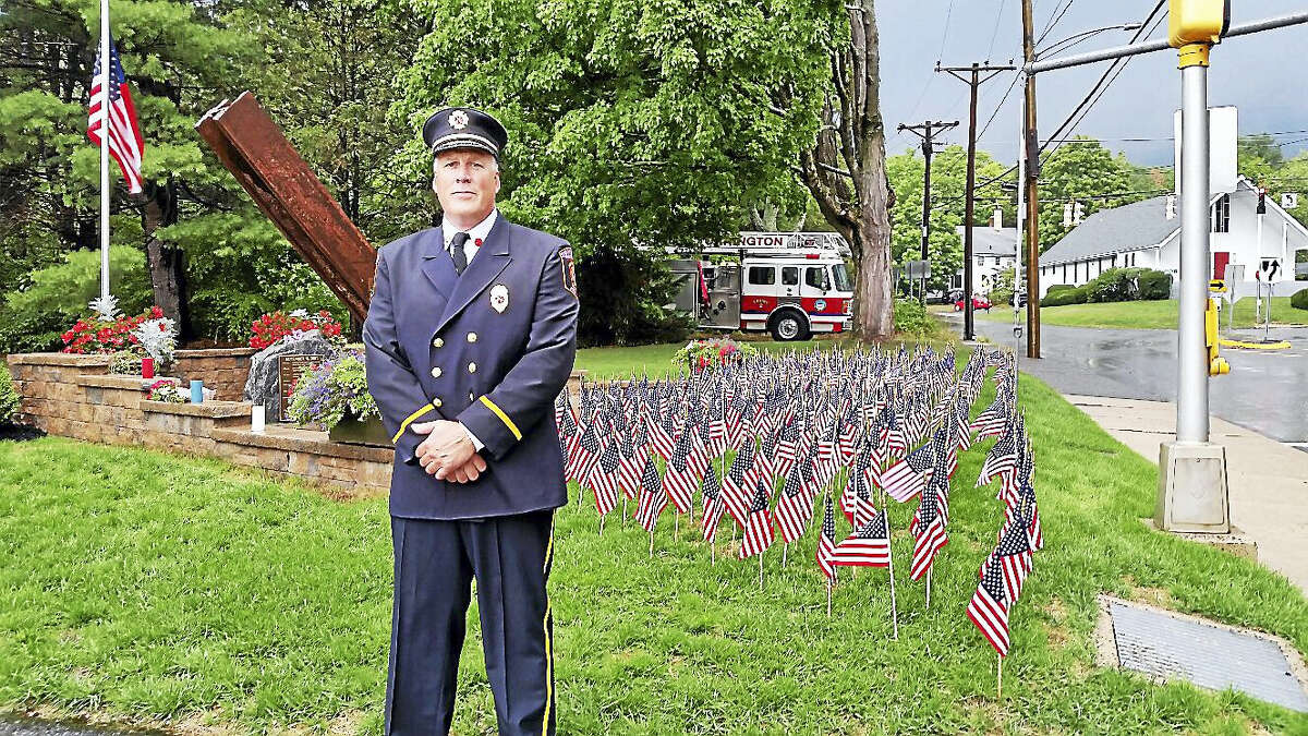 N.F. Ambery photo Torrington Deputy Fire Marshall Todd LaMothe spoke at the ceremony, as clouds approached.