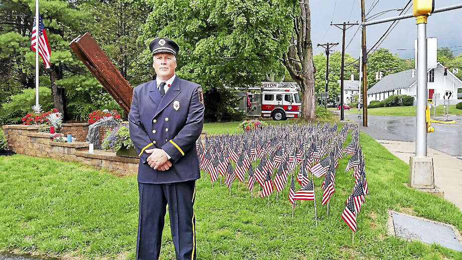 N.F. Ambery photo Torrington Deputy Fire Marshall Todd LaMothe spoke at the ceremony, as clouds approached. Photo: Journal Register Co.