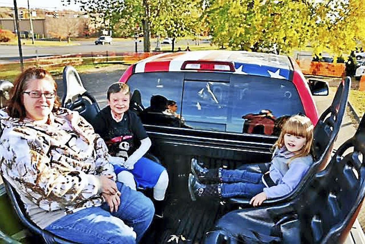 Jonathan Gionfriddo, center, rides a monster truck with mother Brenda and sister Emma. (Contributed photo)