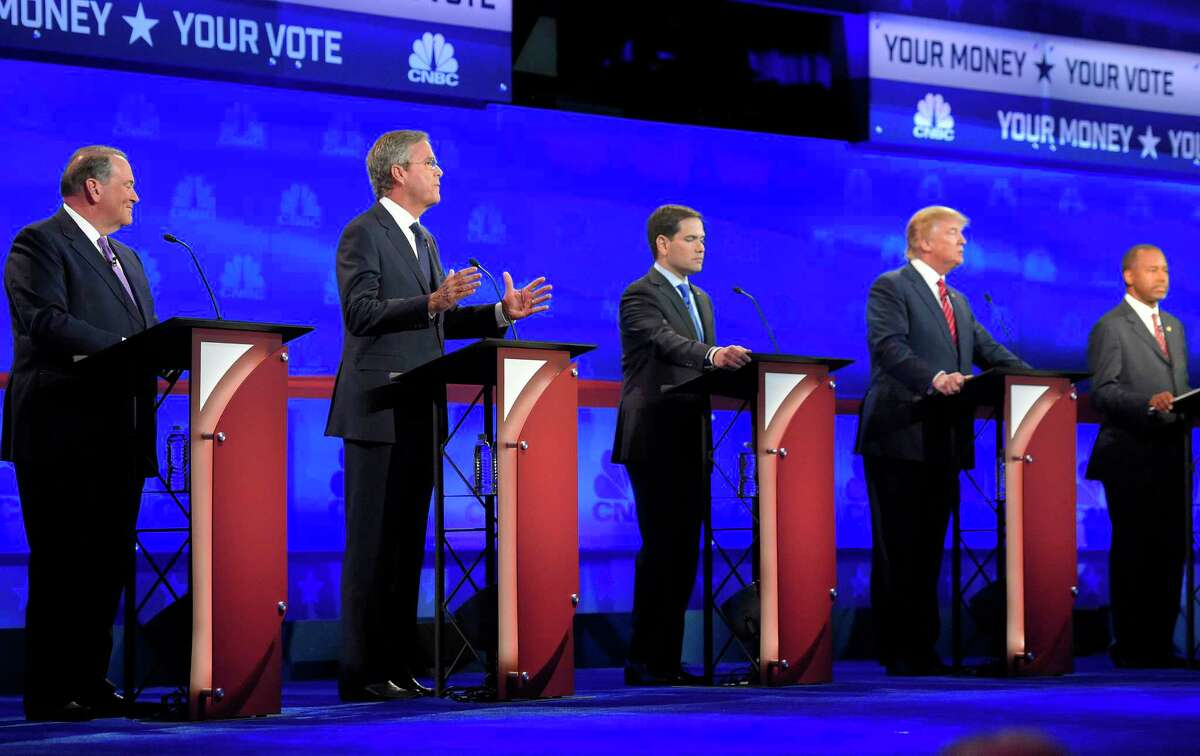 Jeb Bush, second from left, is flanked by Mike Huckabee, left; Marco Rubio, center; Donald Trump, second from right; and Ben Carson during the CNBC Republican presidential debate at the University of Colorado, Wednesday, Oct. 28, 2015, in Boulder, Colo.