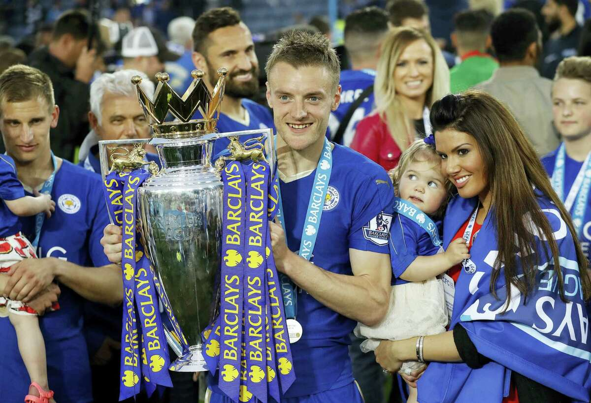 Leicester's Jamie Vardy lifts the trophy as Leicester City celebrates its English Premier League championship at King Power stadium in Leicester, England, on Saturday.
