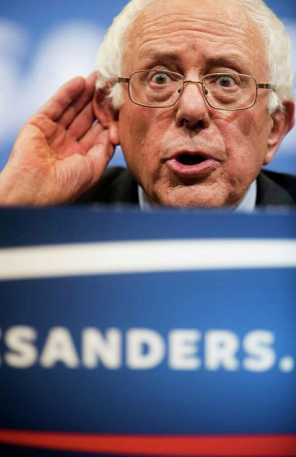Democratic presidential candidate Sen. Bernie Sanders, I-Vt., listens to a student's question at a town hall meeting at George Mason University in Fairfax, Va., on Wednesday. Photo: AP Photo  / FR33460 AP