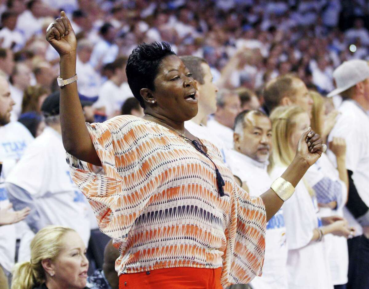 In this 2012 file photo, Kevin Durant's mother, Wanda Pratt, dances on the sidelines during a playoff game. Pratt is the subject of a Lifetime original movie called The Real MVP: The Wanda Durant Story.