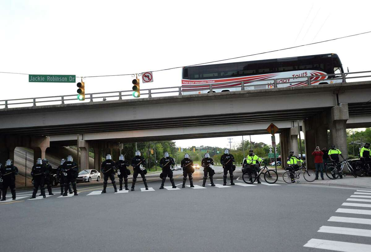 Durham police block access to the Durham Freeway on Friday, May 1, 2015, in Durham, N.C. Hundreds took part in a peaceful protest in solidarity with protests in Baltimore that began at the Durham Police headquarters and ended at the Durham County Detention Center.