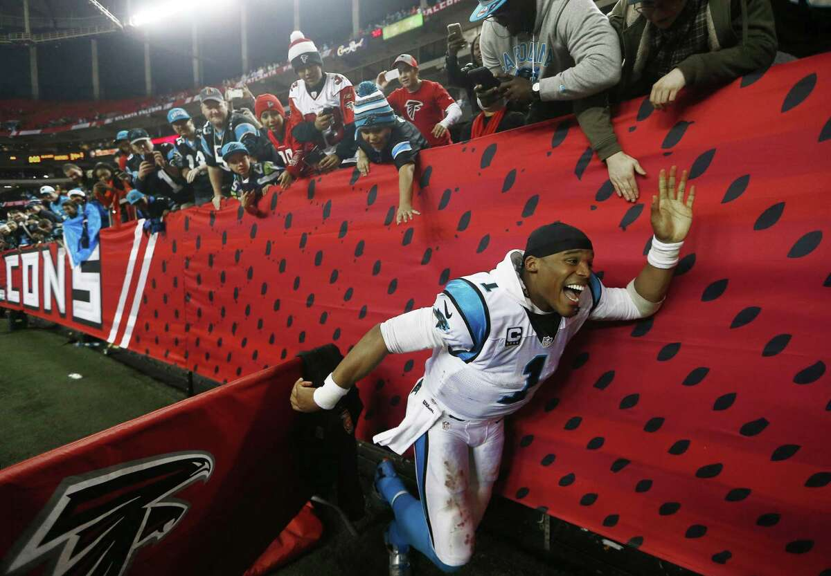 Carolina quarterback Cam Newton greets fans after the Panthers' 34-3 win over the Falcons on Sunday in Atlanta.