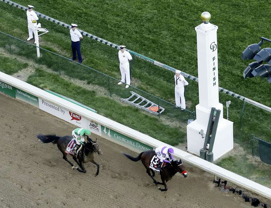 Mario Gutierrez rides Nyquist to victory during the 142nd running of the Kentucky Derby on Saturday. Photo: Charlie Riedel — The Associated Press  / AP