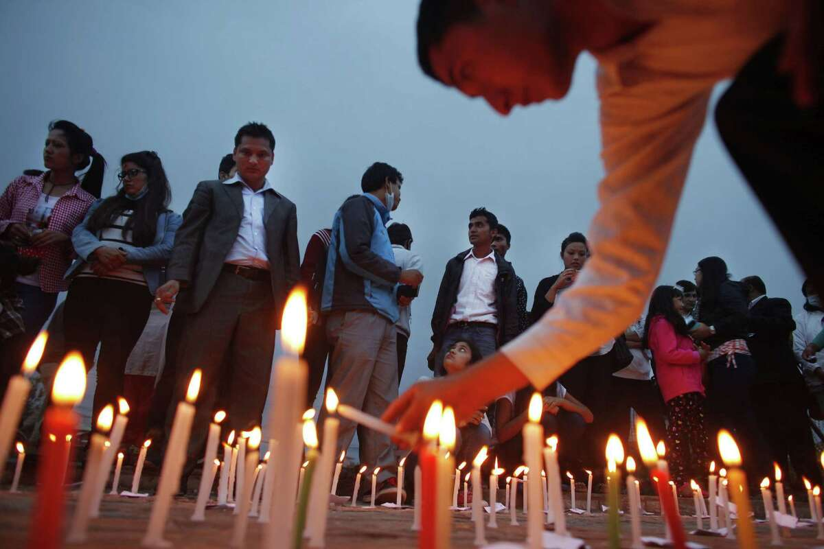 Nepalese participate in a candle light vigil for victims of last week's earthquake in Kathmandu, Nepal, Saturday, May 2, 2015. The magnitude-7.8 earthquake killed thousands of people and the U.N. has estimated the quake affected 8.1 million people, more than a fourth of Nepal's population of 27.8 million. (AP Photo/Niranjan Shrestha)