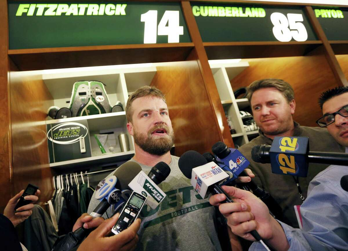 New York Jets quarterback Ryan Fitzpatrick speaks to reporters Wednesday at the team's training facility in Florham Park, N.J.