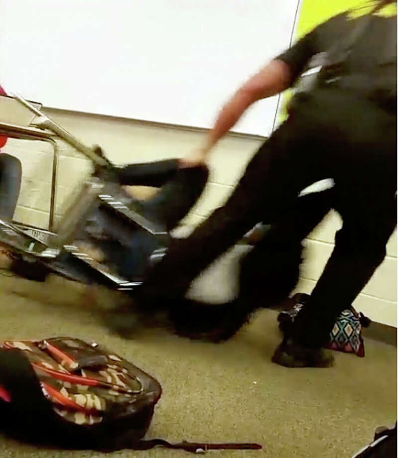 In this Monday photo made from video taken by a Spring Valley High School student, Senior Deputy Ben Fields drags a student across the floor as he removes her from her chair after she refused to leave her high school math class in Columbia S.C. Photo: AP Photo  / Student
