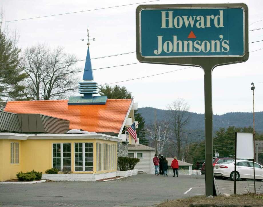 Customers walk into Howard Johnson's Restaurant in Lake George, N.Y. Photo: Mike Groll — The Associated Press  / AP