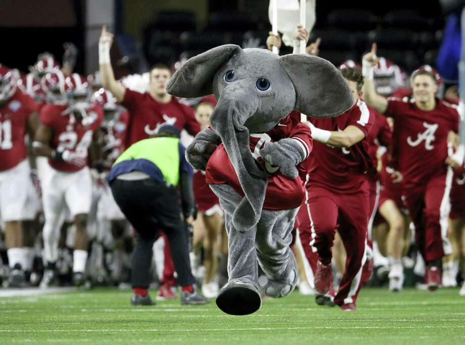 Big Al, the Alabama mascot, takes the field before the Cotton Bowl on New Year's Eve in Arlington, Texas. Register sports columnist Chip Malafronte doesn't see the College Football Playoff and New Year's Eve as a match. Photo: LM Otero — The Associated Press  / AP