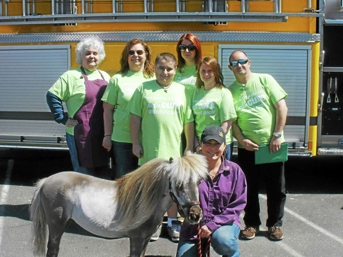 Fran LaPaca, Sharon Hotchkiss, Steven Ross, and other volunteers help out at the Jimmy Fund fundraiser Saturday, May 2, 2015.