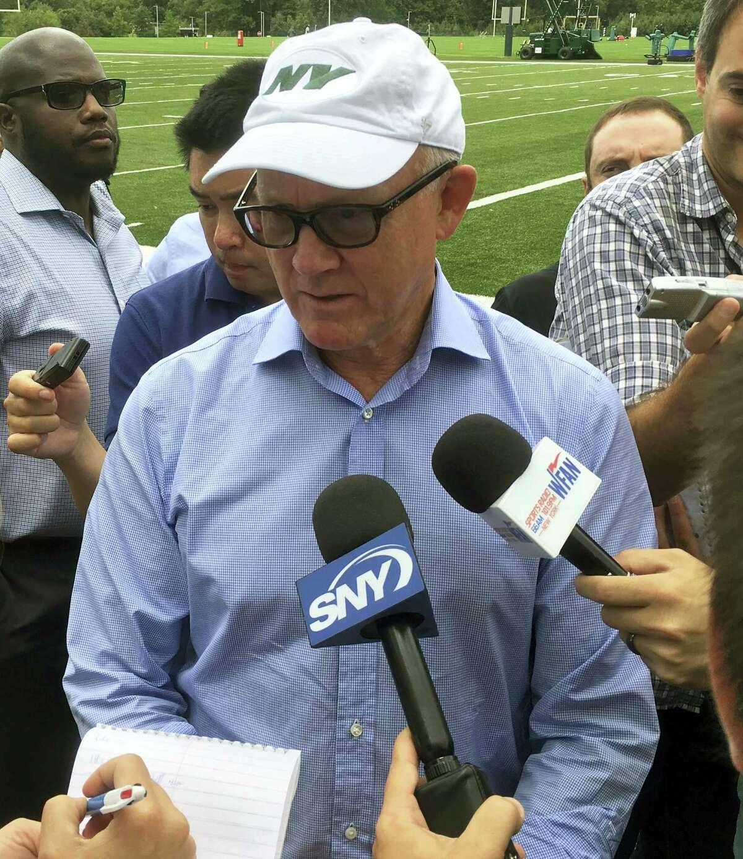 New York Jets owner Woody Johnson speaks to members of the media.