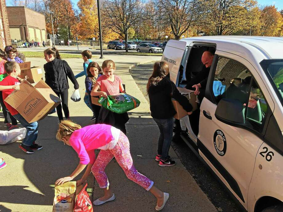 The Forbes School student council donated pet food and supplies to For The Love Of Jack, a local animal welfare group, Friday afternoon. Photo: BEN LAMBERT — The Register Citizen