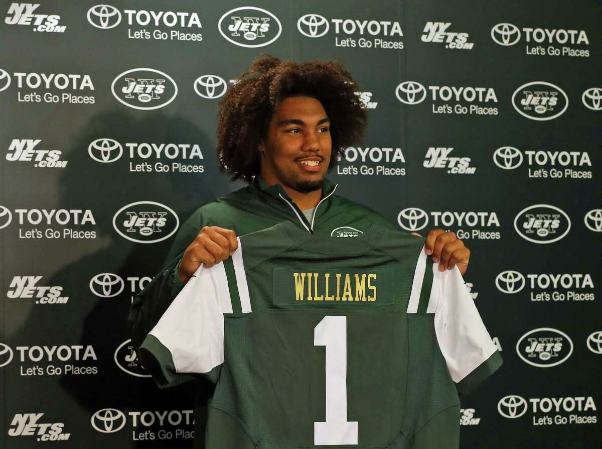 New York Jets draft pick Leonard Williams holds up a jersey as he is introduced to the media Friday in Florham Park, N.J.
