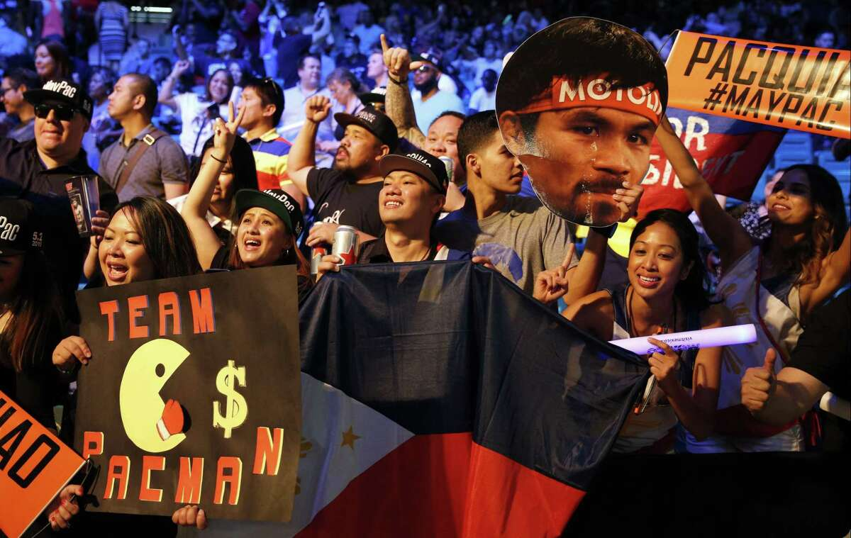 Fans cheer before the Floyd Mayweather Jr. and Manny Pacquiao weigh-in on Friday in Las Vegas.