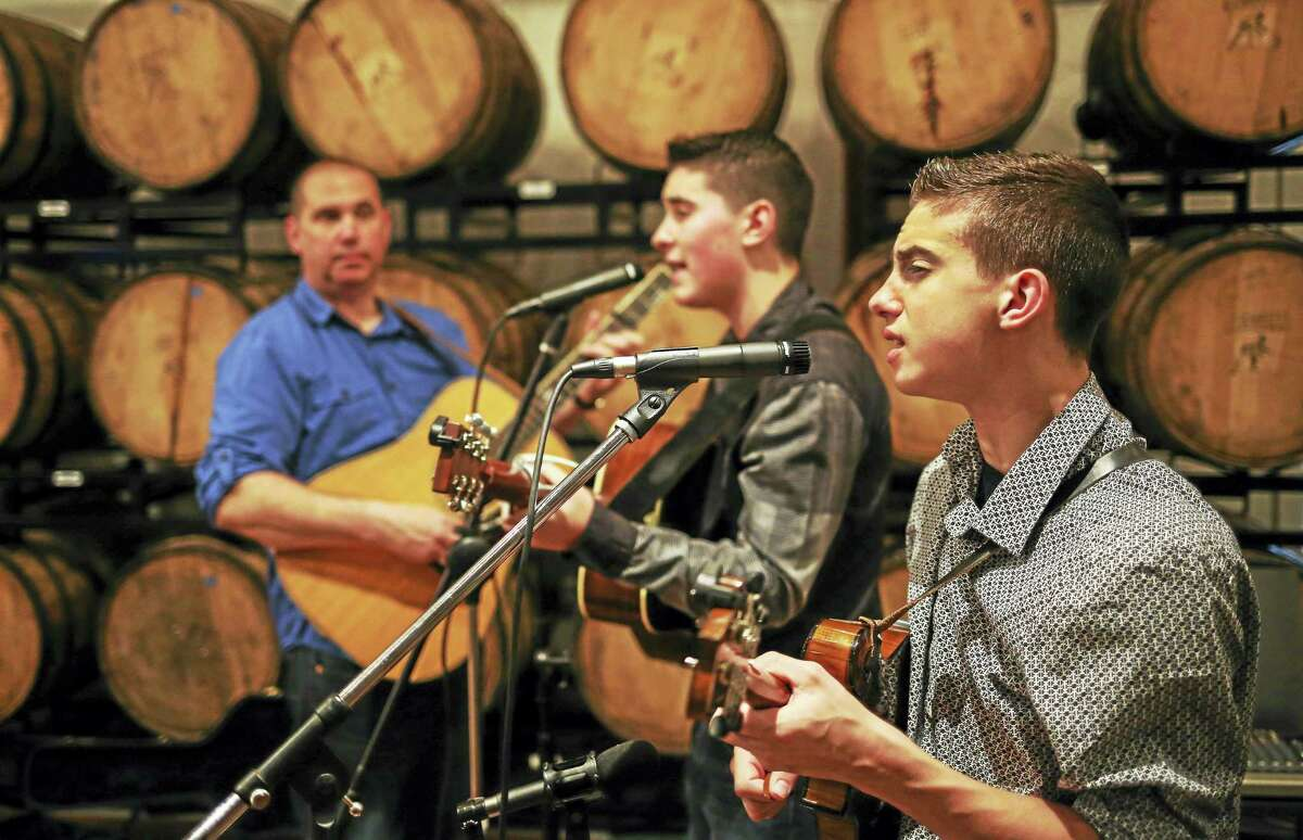 The Zolla Boys, of Torrington, provide entertainment at the Bourbon and Bluegrass event. From left are Larry, Ben and Sam.