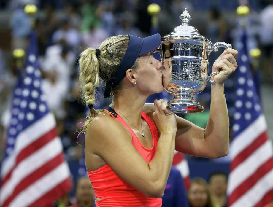 Angelique Kerber kisses the championship trophy after beating Karolina Pliskova in the women's final at the U.S. Open on Saturday. Photo: Darron Cummings — The Associated Press  / Copyright 2016 The Associated Press. All rights reserved.