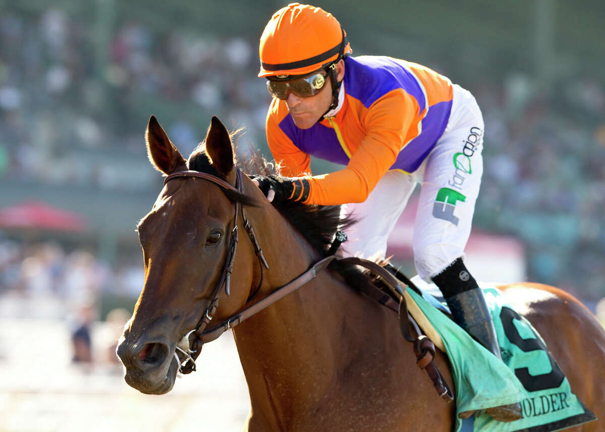 FILE - In this Sept. 26, 2015, file photo, provided by Benoit Photo, Beholder and jockey Gary Stevens.