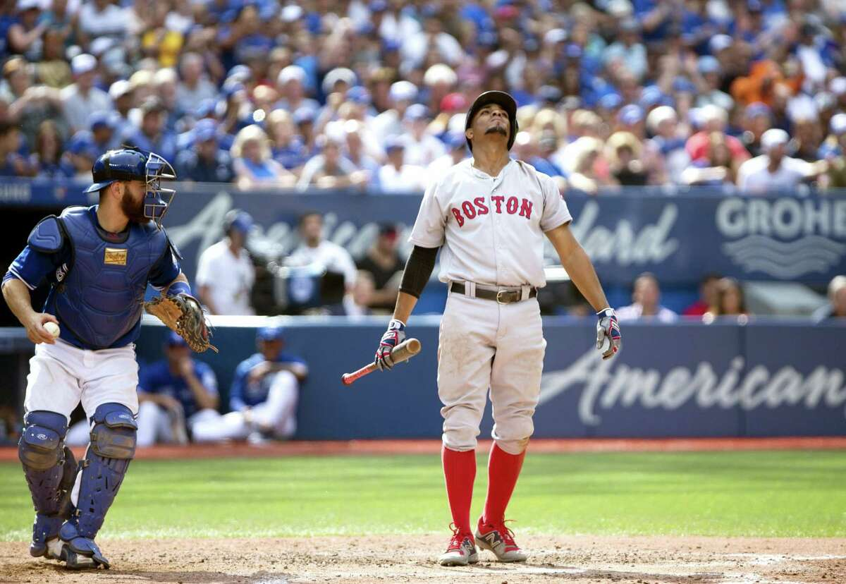 Xander Bogaerts (2) reacts after striking out in the eighth inning on Saturday.