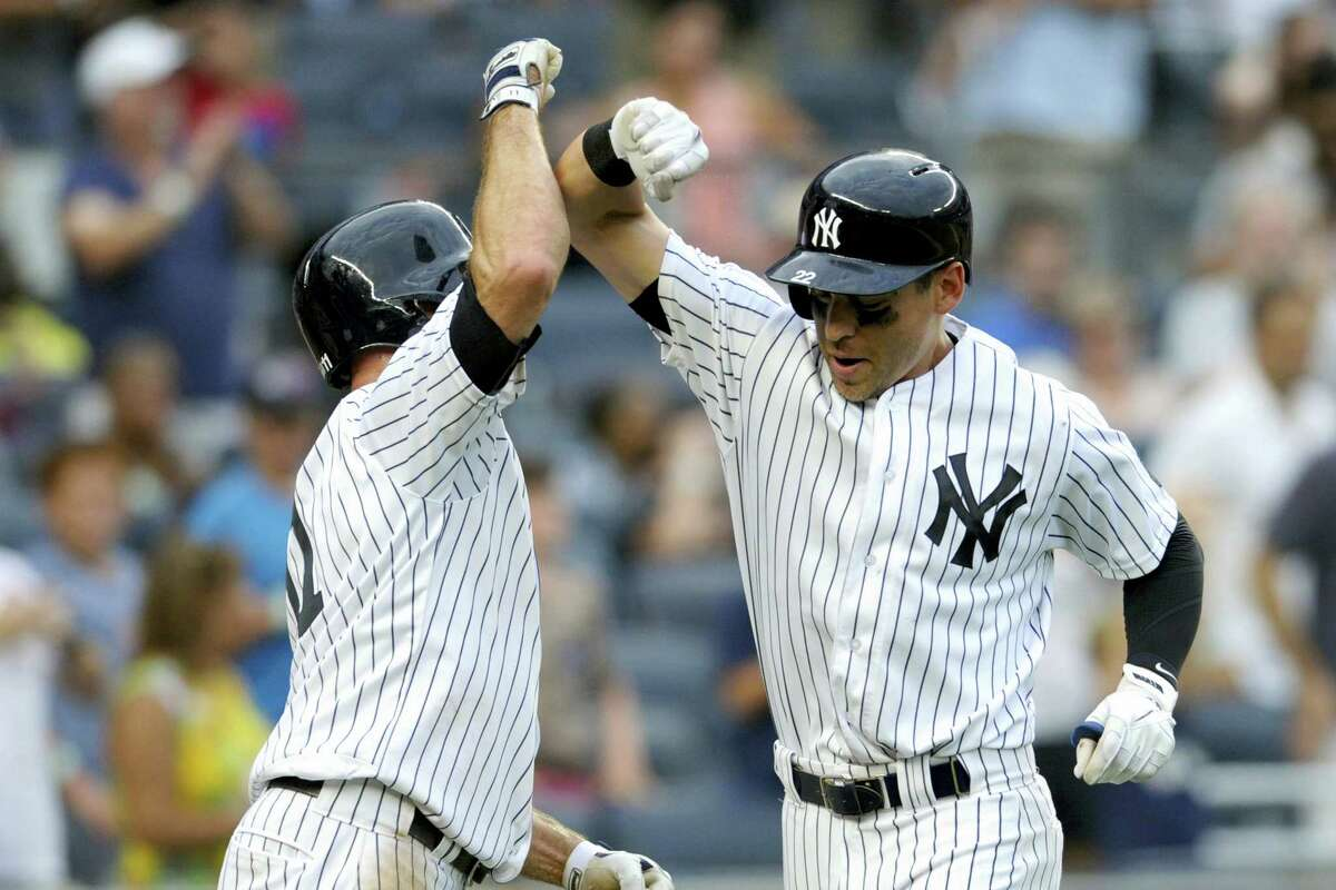 Jacoby Ellsbury, right, celebrates with Brett Gardner after hitting a two-run home run in the sixth inning Saturday.