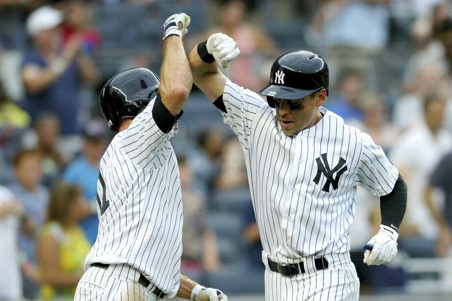 Jacoby Ellsbury, right, celebrates with Brett Gardner after hitting a two-run home run in the sixth inning Saturday. Photo: Bill Kostroun — The Associated Press  / FR51951 AP