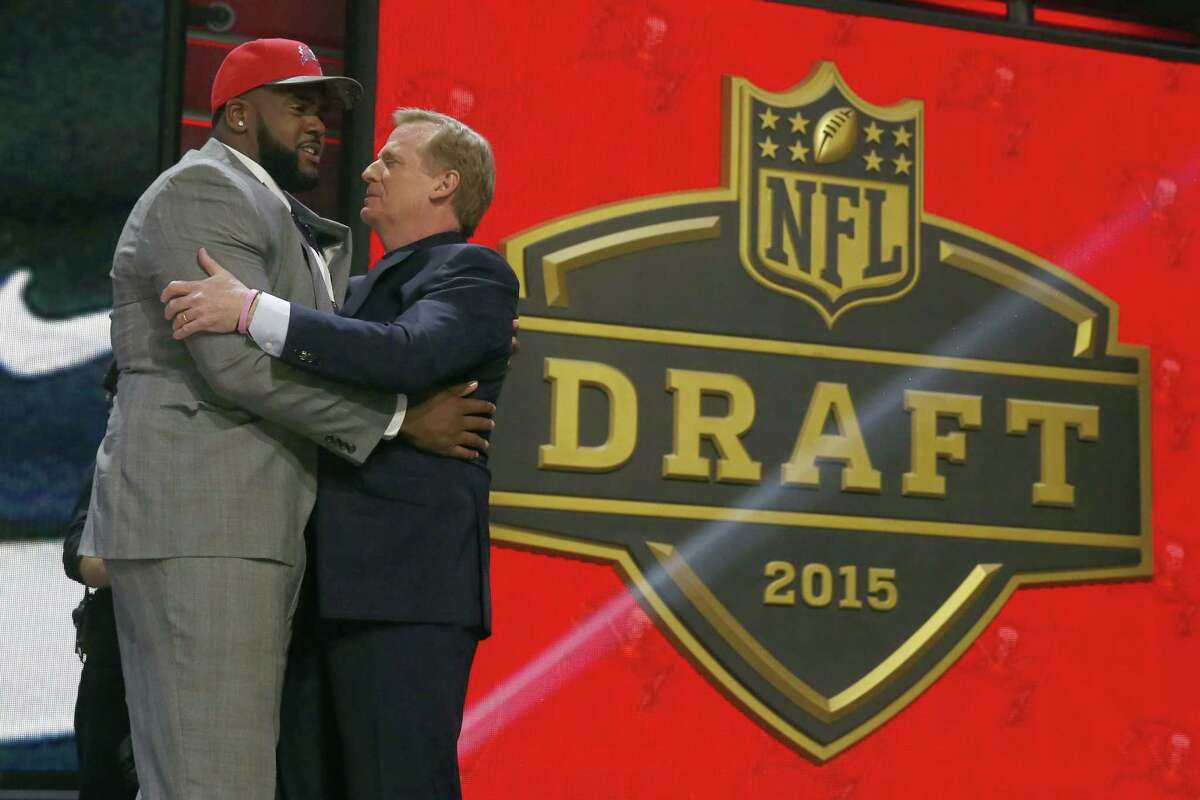 Penn State offensive lineman Donovan Smith celebrates with NFL commissioner Roger Goodell after being selected by the Tampa Bay Buccaneers as the 34th pick in the second round of the 2015 NFL Football Draft, Friday, May 1, 2015, in Chicago. (AP Photo/Charles Rex Arbogast)