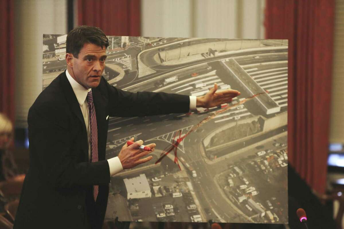 FILE - In this Monday, Nov. 25, 2013, file photograph, taken in Trenton, N.J., Port Authority Executive Director Bill Baroni explains why the traffic entrances were closed onto the George Washington Bridge, causing traffic delays two months ago, with an aerial photo of the entrances and tolls on the GWB. Federal prosecutors have announced a court proceeding, scheduled for Friday, May 1, 2015, involving the 2013 traffic jams on the George Washington Bridge, an investigation that has loomed over New Jersey Gov. Chris Christie as he considers a presidential run. (Chris Pedota/The Record of Bergen County via AP) ONLINE OUT; MAGS OUT; TV OUT; INTERNET OUT; NO ARCHIVING; MANDATORY CREDIT